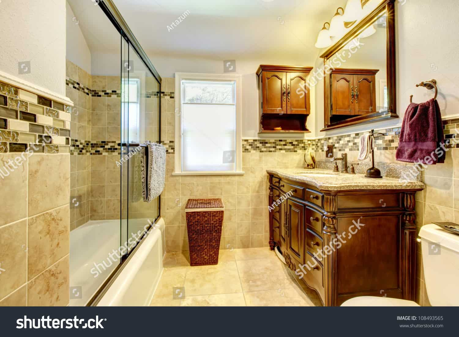 stock photo classic bathroom with natural stone tiles and wood cabinet 108493565