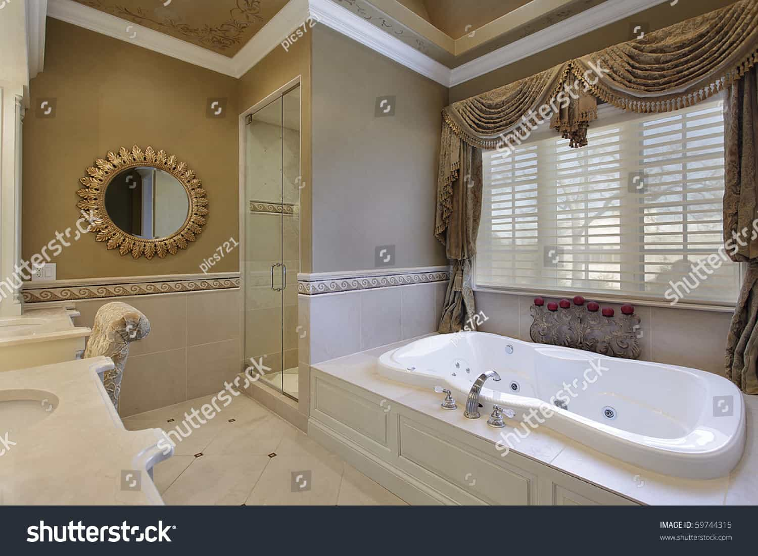 stock photo master bath in elegant home with large tub 59744315