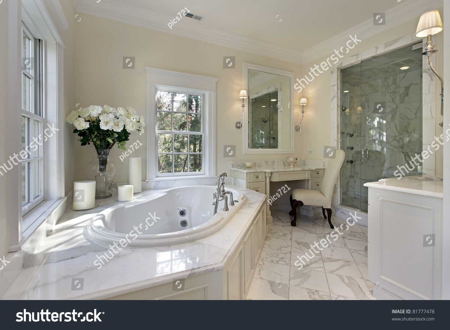 stock photo master bath in luxury home with step up tub 81777478