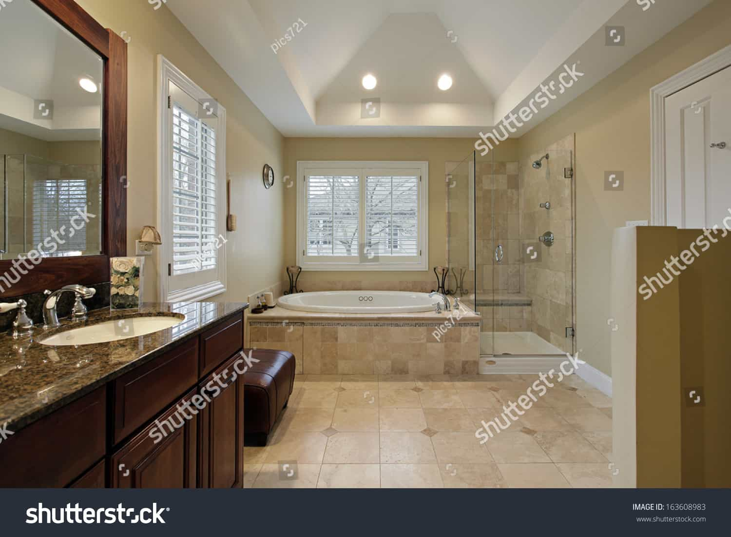 stock photo master bath with glass shower granite counter 163608983
