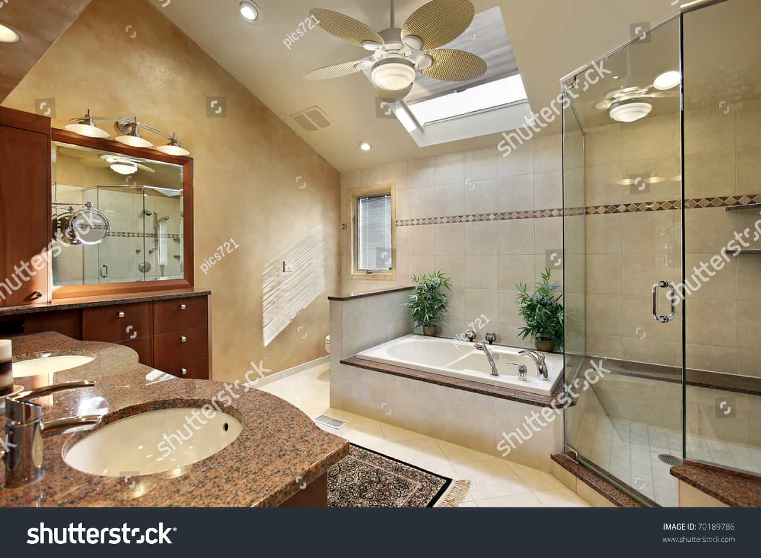 stock photo modern master bath with glass shower and skylight 70189786