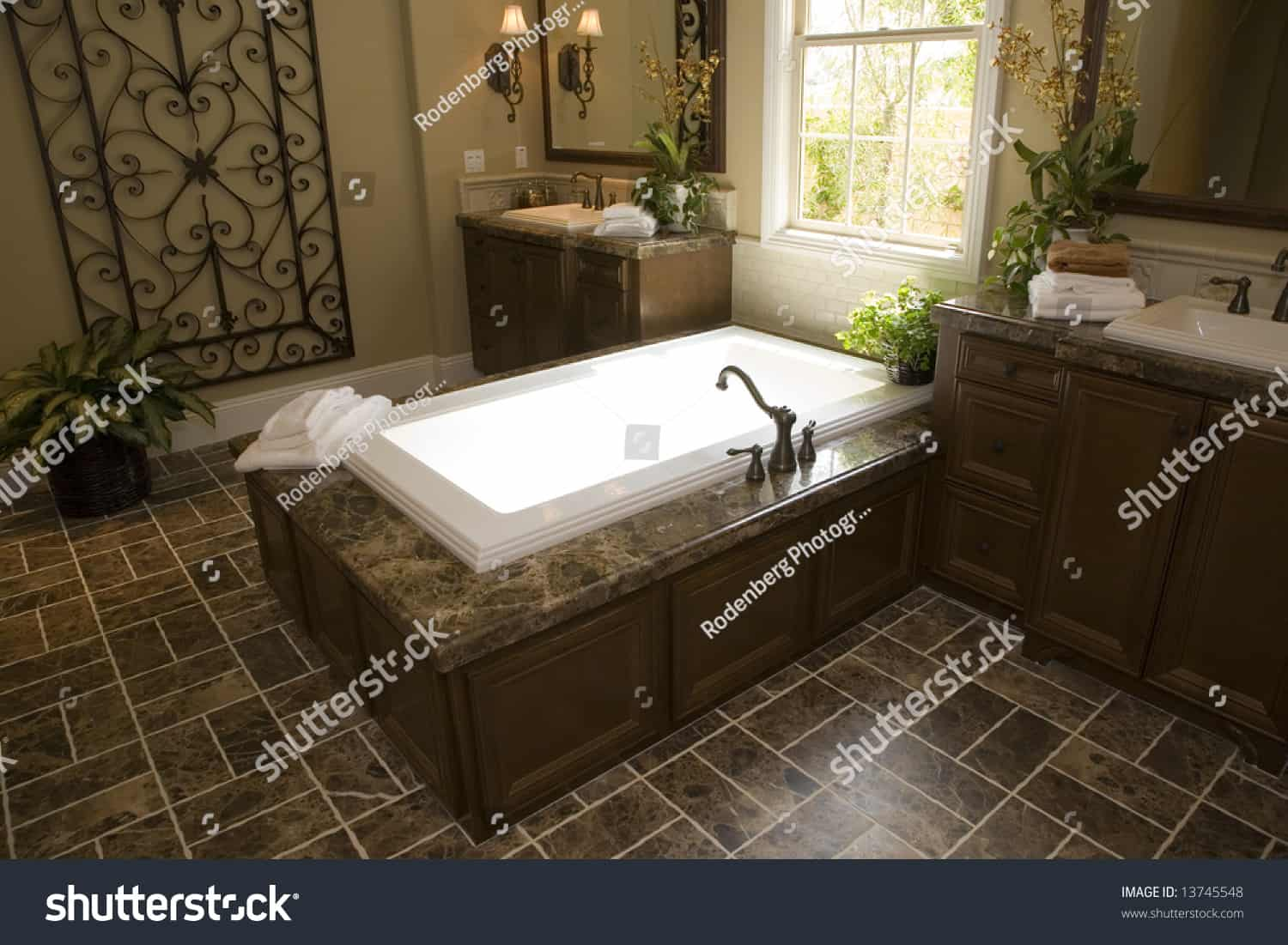 stock photo upscale bathroom with a modern tub and tile floor 13745548