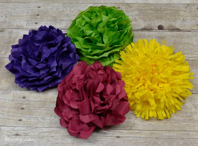 Here are some great tissue paper flowers that can be used for so many different things. Hang them, add them to centerpieces, or attach them to picture frames. These multi-use flowers always look great.