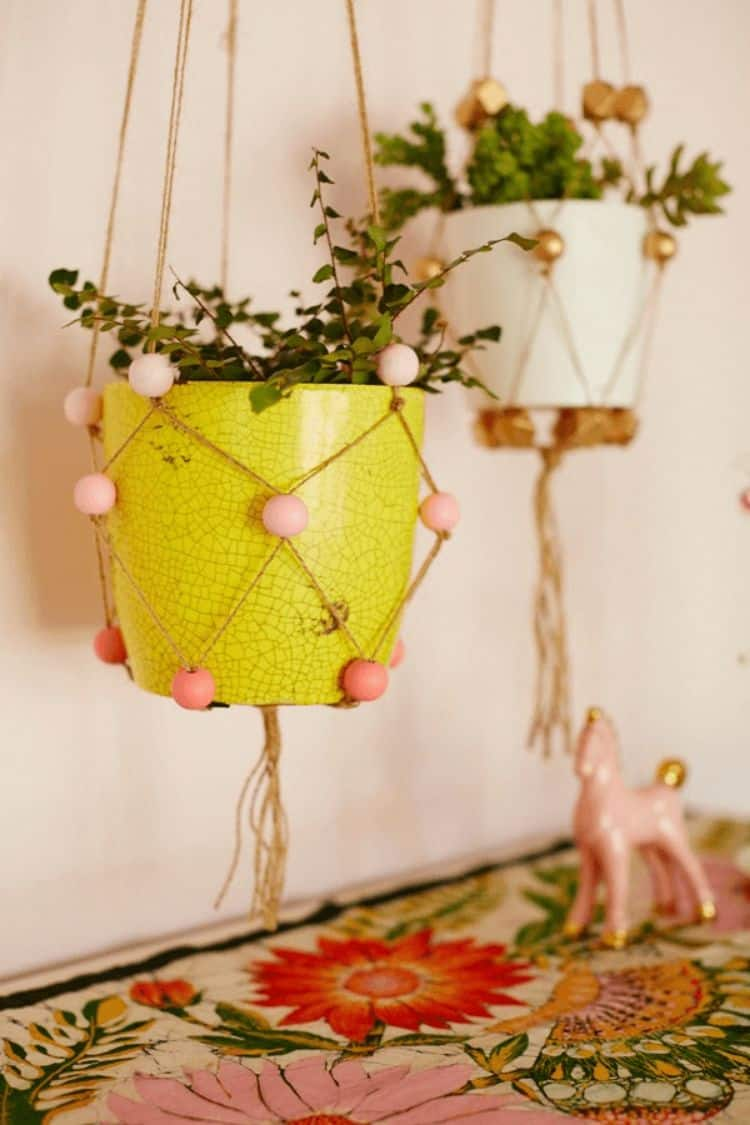 These custom bead and twine plant hangers are a fun and colorful way to hang your potted plants. Use colors that either match or contrast to strengthen your designs and color palette.