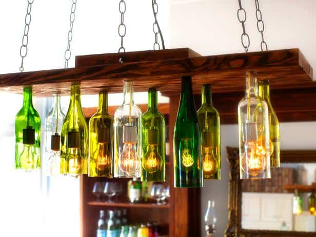 Here is a project that will transform your hanging bulbs into an amazing and intriguing lighting fixture. Different colored and shaped bottles on this fixture give a dynamic and layered look.