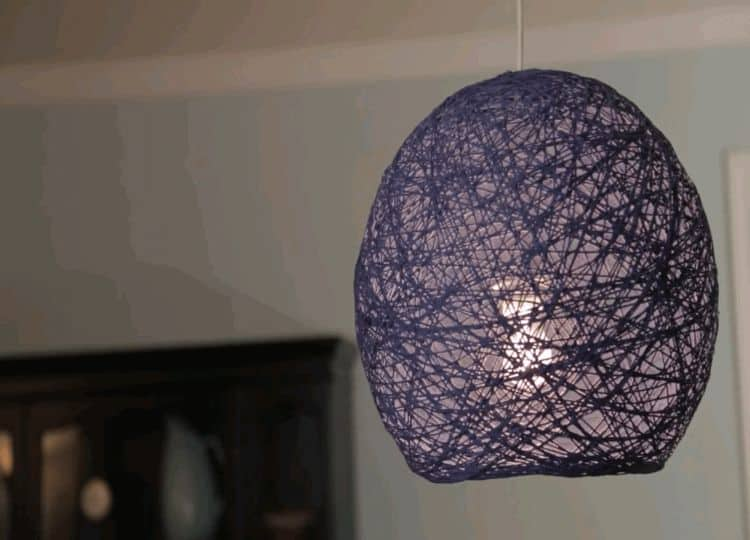 This hanging lampshade project made from yarn is both beautiful and creative. This project is also easy and fun. The chaotic pattern of the yarn along with the sleek shape of the design makes it great for modern style.